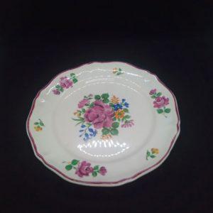 4 petites assiettes aux motifs rose bleu vert et ocre de Saint Amand France porcelaine